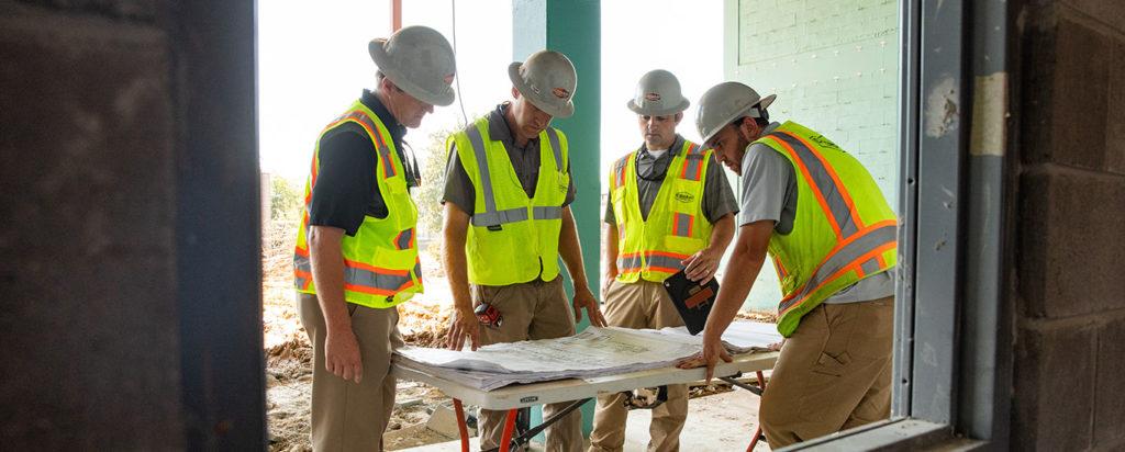 Codaray Employees around a table
